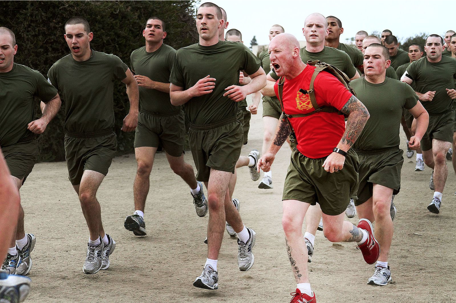 Drill instructors of Company C encourage recruits to exert maximum effort